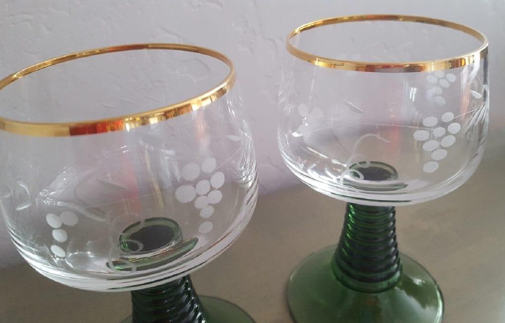 green stemmed wine glass