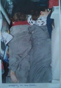 children sleeping on a plane