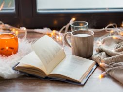 book and coffee or hot chocolate on window sill